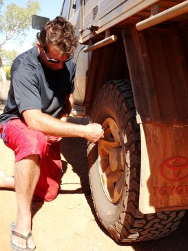 Tire pressure, the right tire pressure, is an important aspect of travel on gravel roads. Scott letting out air before we take on the road to Purnululu