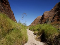 along a sandy creek bed and impressive cliffs