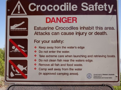 Be Croc-Wise. I like the 'keep away from the water's edge' yet the pontoon the sign guards is smack on the water