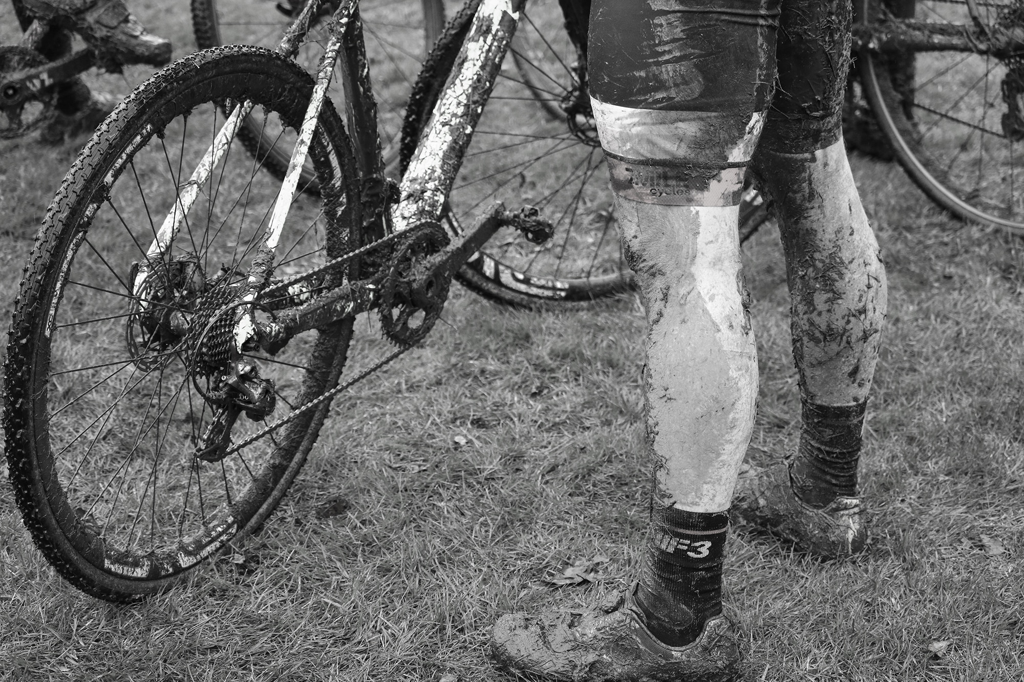 Muddy legs of Cyclocross Cyclist