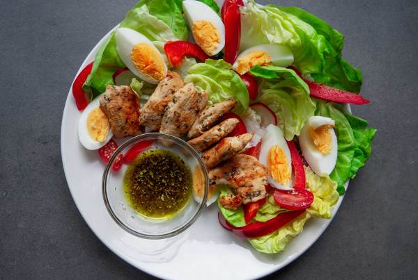 Salad with Grilled Chicken and Eggs preparation ready to eat