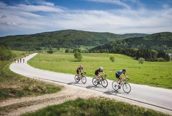Group of cyclists at climb