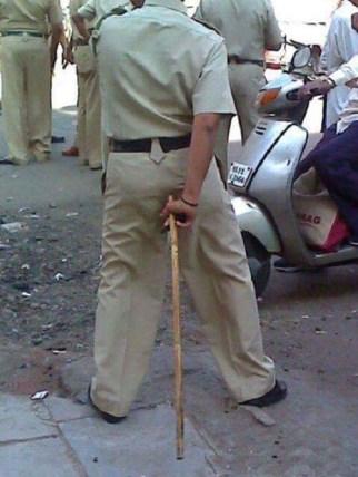 Keistering through his police uniform