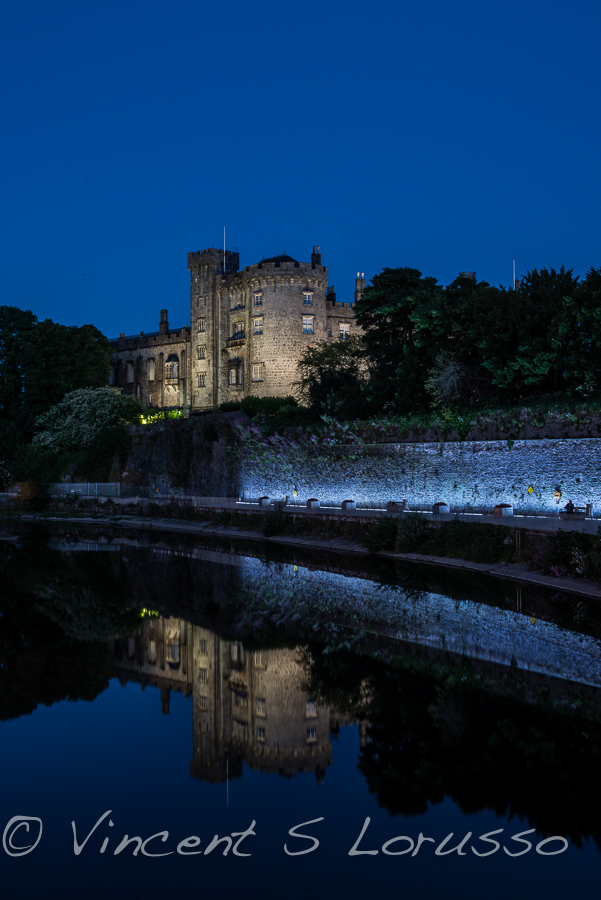 Kilkenny Castle on the bank of the River Nore and night.