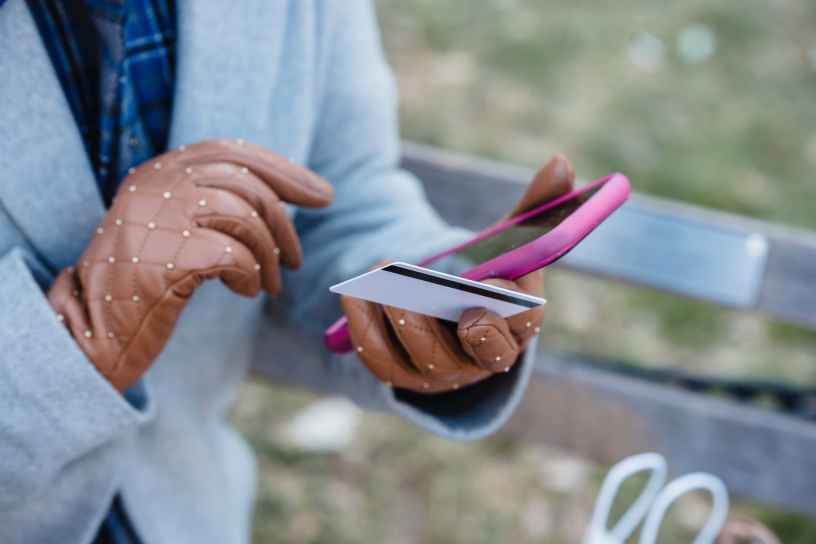 crop unrecognizable woman with online payment via smartphone in park