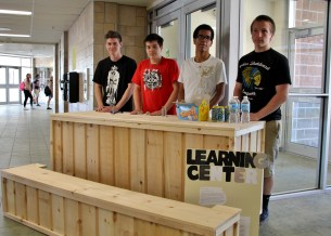 Halifax West Grade 10 students showcase the production cart they built as part of service learning, for Learning Centre students to transport their mobile shop. Michael Joyce, Ben Kuehn, Paul Chitate, Kaleb Mathews (L-R)