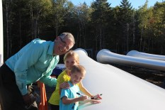 The first to sign the 49 metre wind turbine blade was Sophie (8) and Alexander (5) Norman, photographed with Chebucto Pockwock Lake Wind Field president Terry Norman.