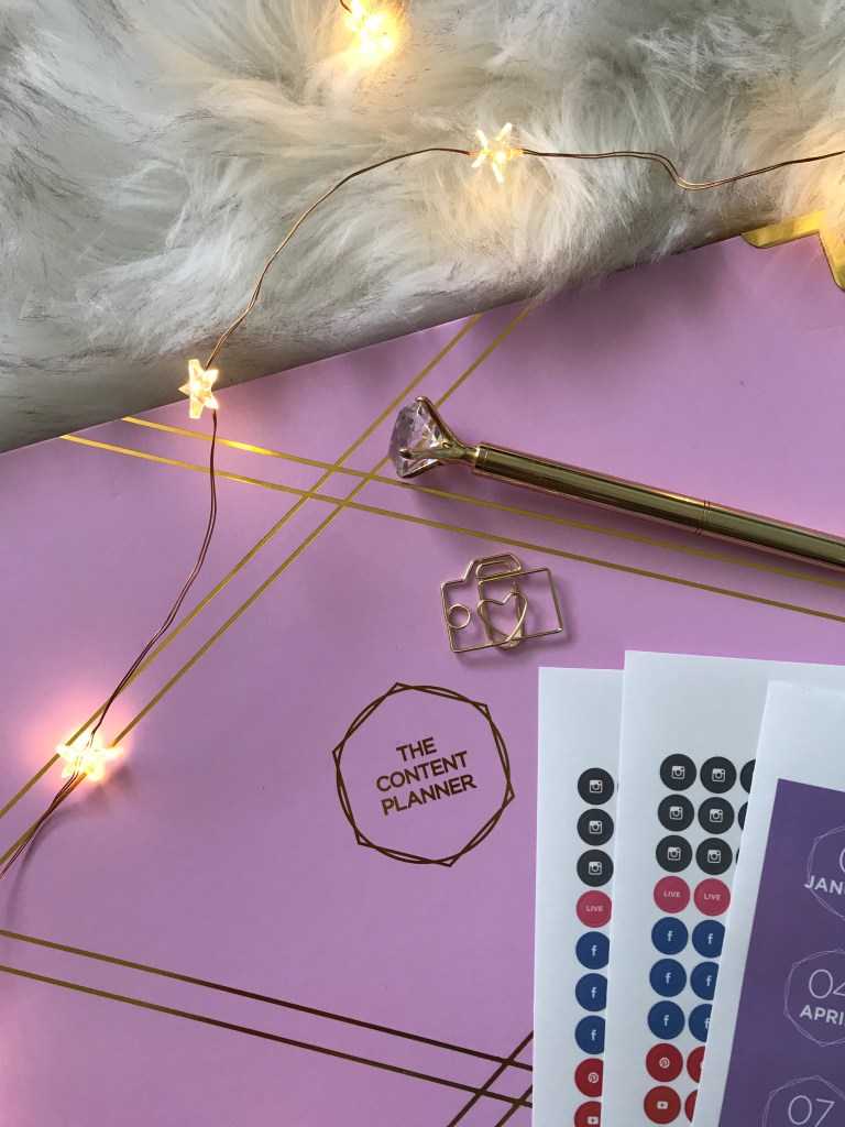 the content planner flat lay. Stickers, pen, fur rug, twinkly lights.