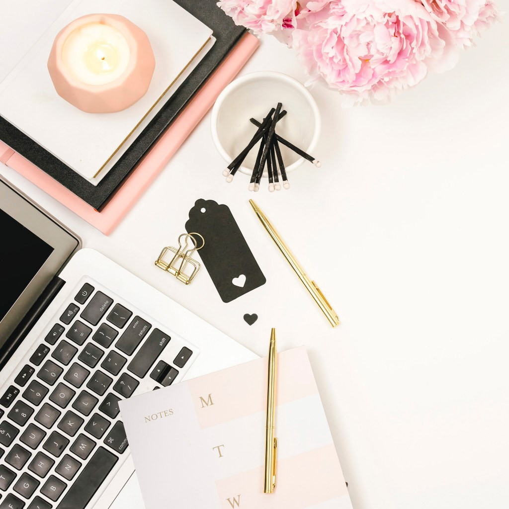 desktop flat lay. macbook, candle, matches, binder clips, golden pens, to do list, peonies. 5 easy ways to get started with affiliate marketing