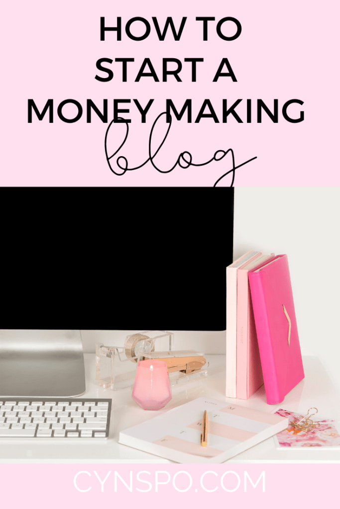 how to start a money making blog. laptop, pink notebooks, candles, binder clips, keyboard. cursive and block text. pink background.