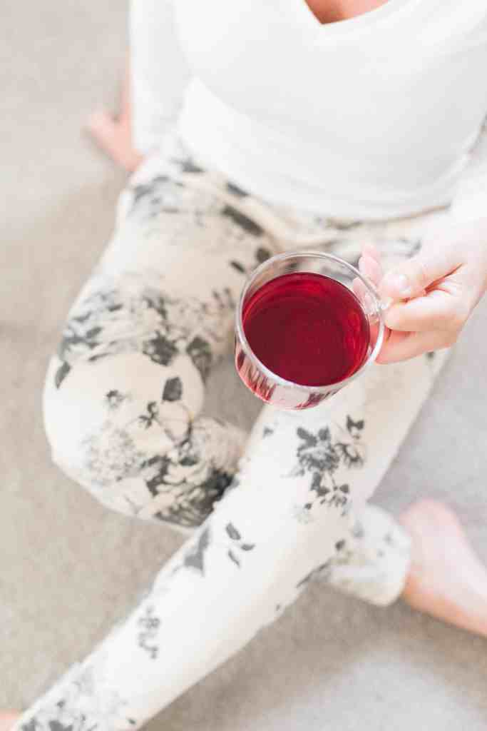 girl sitting with cup of tea, white shirt and patterned leggings. 10 Things That Do Not Determine Your Self-Worth