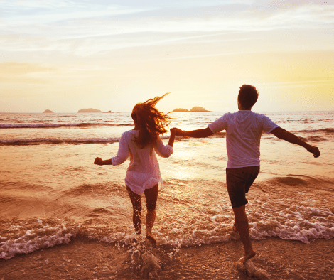couple running into water on the beach holding hands. 50 Things to Be Grateful For