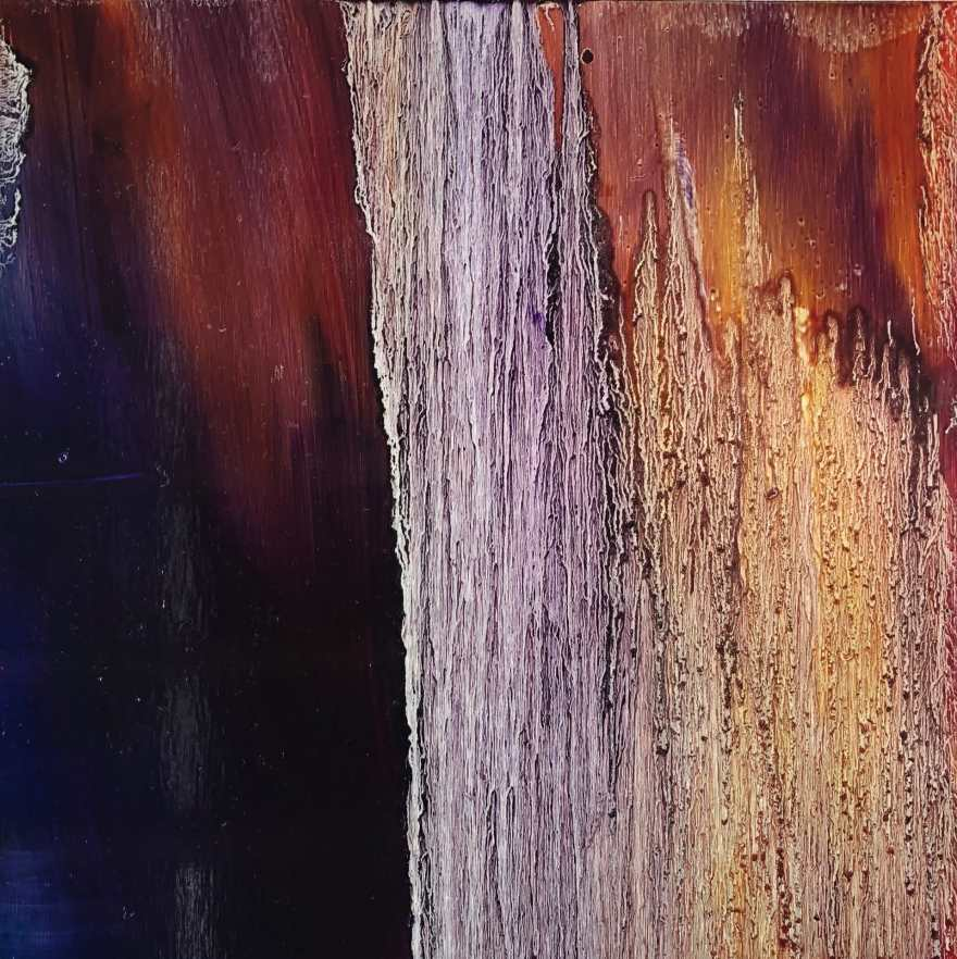 An original oil painting by Cynthia McLoughlin. Deep purple blends left to right with deep burgundy. Midway, vertical silver drips cascade top to bottom going gold as colors move right. Painted on a reflective, brushed aluminum panel.