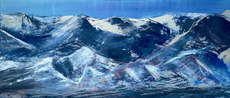 Blue and silver mountain scape of the Wasatch Mountains in Park City, Utah.