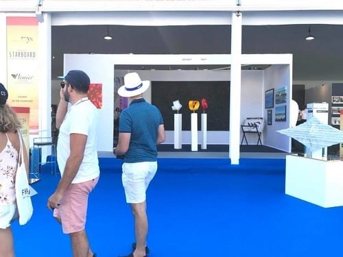 Buyers looking into the Art UpClose booth at the Monaco Yacht Show, 2019.