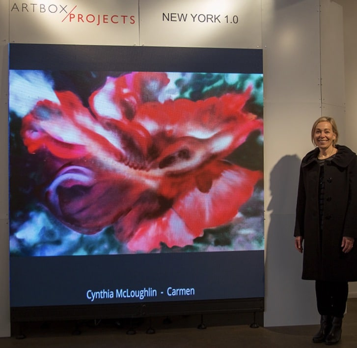 Cynthia McLoughlin, artist along side of the digital image of her painting, Carmen, at the Stricoff Gallery in Chelsey, NYC in 2018.