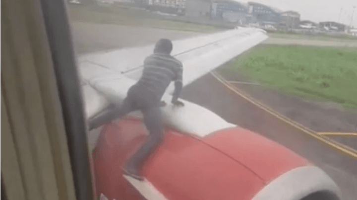 Man causes panic by climbing plane on airport runway