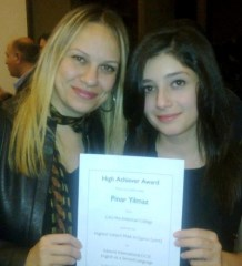 Pınar Yılmaz (right) receives her certificate