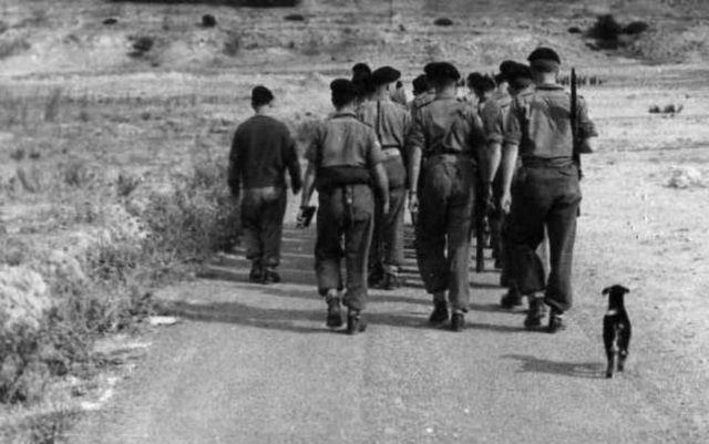 Best trained goat in the British army (Corporal Wally Sherwood leading the men)