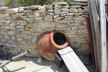 A very old pot built into a wall