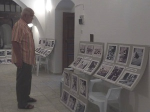 Frank admires the photographs