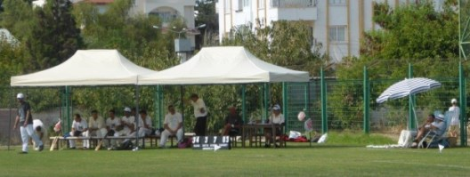 Kyrenia Kings waiting to bat & some of the crowd.