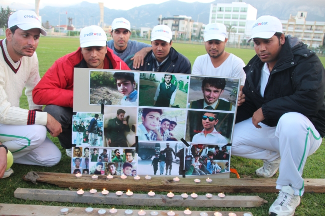 Girne cricket team with the memorial candles