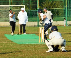 TRNC's Sajjad Kamal bowling with North Cyprus Umpire Keith Lloyd and Nicosia's Andy Cole batting