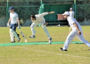Rehmat Khattak bowling with TRNC captain Danish Afridi fielding.The batsman is Nicosia captain Dan Brown image