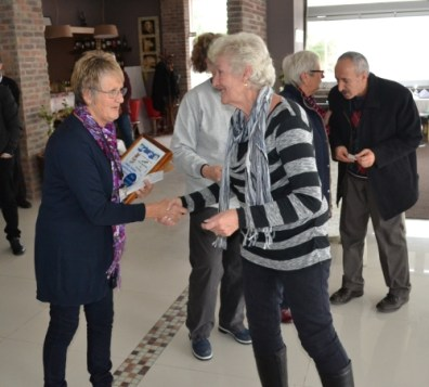 Carole King from Tulips receives a donation from Barbara Fursman