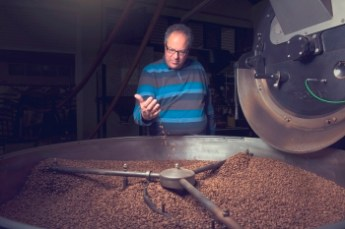 Mr Özerlat checking the coffee beans
