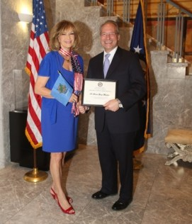 John Koenig US Ambassador to Cyprus makes an award