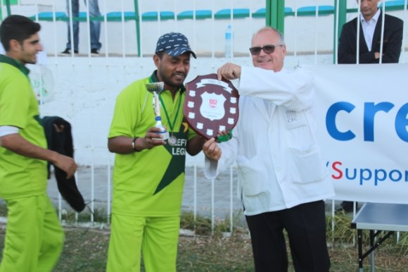 Umpire George Ward presenting the Creditwest trophy to Lefkoşa Fighter's Captain Nisar