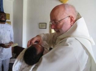 Revd Mike baptises Kendricks Chiedoziem Idoko