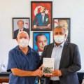 Richard Chamberlain presents his Varosa books to Gazimağusa Mayor (1) image