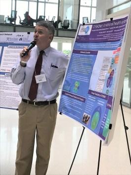 Chris presenting Poster