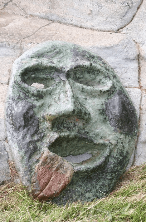 a whimsical face crafted from concrete by John Czegledi, an artist from the Comox Valley on Vancouver Island