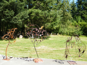 a series of three patina metal sculptures by Courtenay based artist and inventor John Czegledi