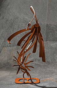 a patina metal abstract swan sculpture by Courtenay based metal and concrete artist John Czegledi