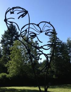 patina metal faces by artist and designer John Czegledi