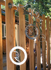 a series of stainless metal circles created from scrap metal by artist and inventor John Czegledi from the Comox Valley on Vancouver Island