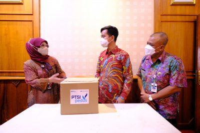 gibran terima bantuan dariPT Surveyor Indonesia