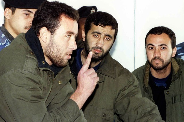 (L-R) Raed al-Attar, Mohammed Abu Shammala and Osama Abu Atah from Hamas are seen on February 27, 1999. An Israeli air strike killed three senior Hamas military commanders in the Gaza Strip on August 21, 2014. Hamas named the men as Mohammed Abu Shammala, Raed al-Attar and Mohammed Barhoum
