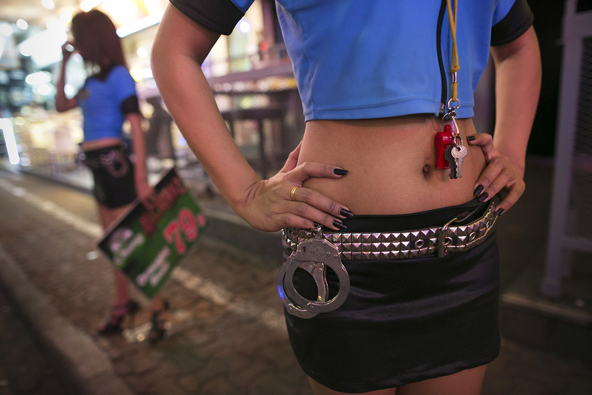 Thai bar girls tout for customers outside a venue in the red light district of Pattaya