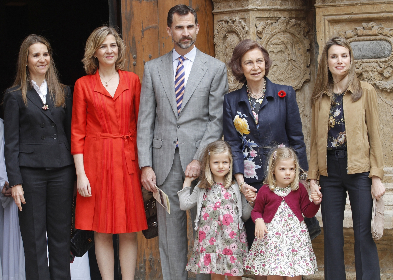 Spanish King Felipe and his sister Cristina pose after attending an Easter mass, photo by Reuters/Enrique Calvo
