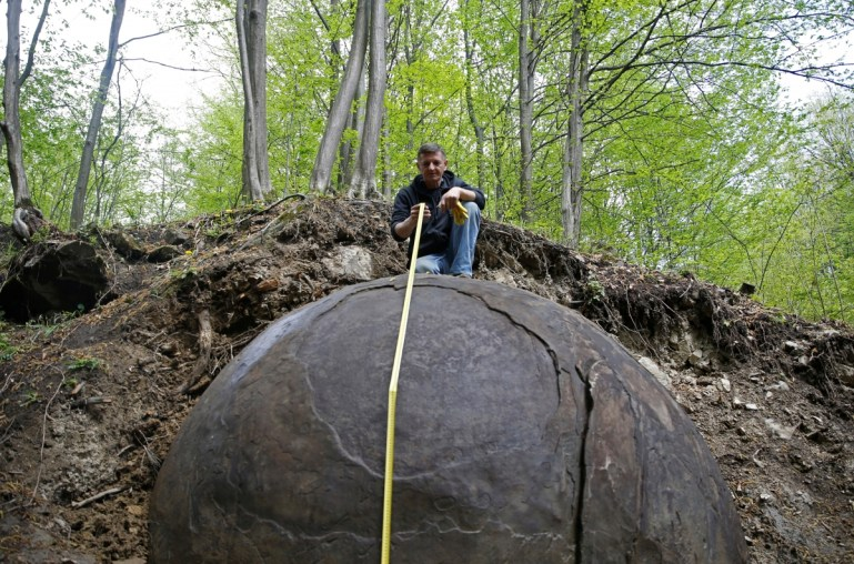 Archaeologists have found a giant mysterious sphere embedded in the ground in Bosnia
