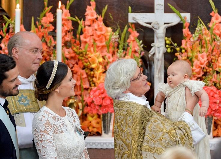 Prince Alexander christening  Lovable Prince Alexander of Sweden cradled via glamorous mom Princess Sofia at christening prince alexander christening