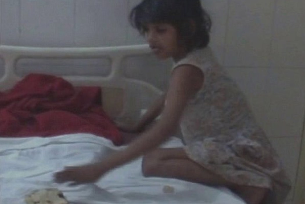 Image result for Indian police trying to identify girl found in forest living with monkeys