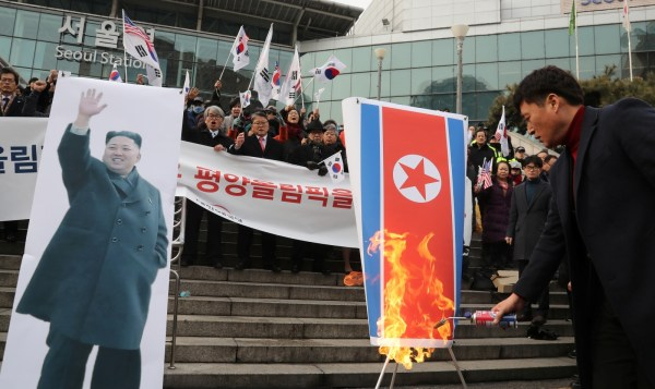 Protesters in Seoul burn North Korean flag ahead of ...