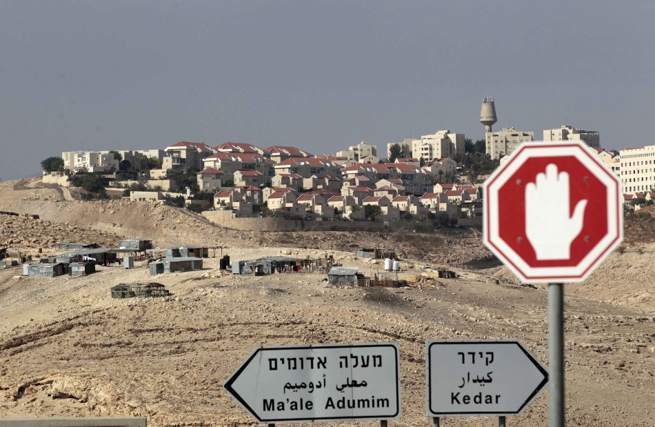 Sign posts are seen in front of the West Bank Jewish settlement of Maale Adumim